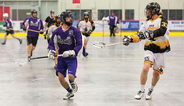 """Northland Nissan Assault player Doug Porter looks to make a play against PoCo Hitmen defender Lucas Lehtimcki on Sunday afternoon at Kin 1 during the gold medal game of the 2019 B.C. Senior """"C"""" provincial lacrosse championship and Glen Moose Scott Invitational lacrosse tournament. Citizen Photo by James Doyle       July 28, 2019"""