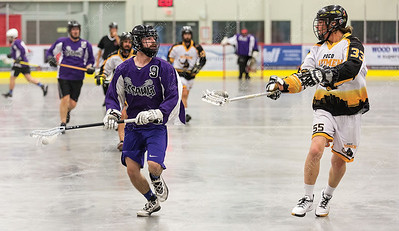 "Northland Nissan Assault player Doug Porter looks to make a play against PoCo Hitmen defender Lucas Lehtimcki on Sunday afternoon at Kin 1 during the gold medal game of the 2019 B.C. Senior ""C"" provincial lacrosse championship and Glen Moose Scott Invitational lacrosse tournament. Citizen Photo by James Doyle       July 28, 2019"