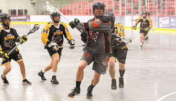 """Westwood Pub Devils player Scott Anderson looks to get a shot off against the PoCo Hitmen on Saturday night at Kin 1 as the two teams met in the Senior """"C"""" Provincial lacrosse championship and Treasure Cove Casino Senior Invitational lacrosse tournament. Citizen Photo by James Doyle      July 27, 2019"""