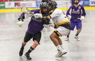 "Northland Nissan Assault player Drew Doig drives to the net against PoCo Hitmen defender Quinton Pavan on Sunday afternoon at Kin 1 during the gold medal game of the 2019 B.C. Senior ""C"" provincial lacrosse championship and Glen Moose Scott Invitational lacrosse tournament. Citizen Photo by James Doyle       July 28, 2019"