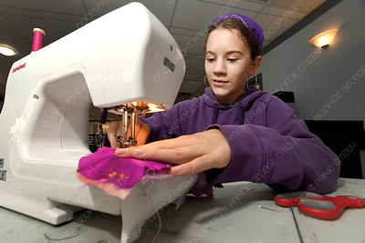 Isobel Bourque, 12, works on a small bag sewing project in the intermediate class at Theatre NorthWest's Sewing Camp Tuesday afternoon. There are daily drop in sewing classes every morning this week as well at the theatre. Sewing camps of various levels continue through the rest of the summer. Citizen photo by Brent Braaten