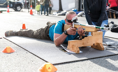 Travis Mallia tries the biathon laser rifle shooting at the CrossRoads Powersports, Skiing and Snowboarding Festival on Saturday morning. Citizen Photo by James Doyle