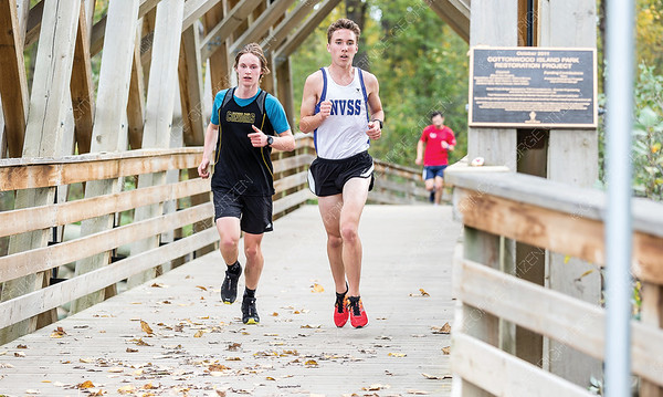 Runners take to the trails at Cottonwood Island Park on Saturday morning while competing in a high school cross country running race. Citizen Photo by James Doyle