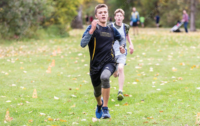 Runners sprint to the finish line at Cottonwood Island Park on Saturday morning while competing in a high school cross country running race. Citizen Photo by James Doyle