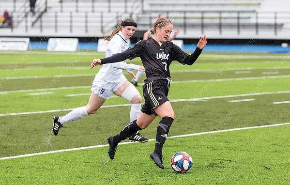 UNBC Timberwolves midfielder Paige Payne looks to make a play with the ball in front of Mount Royal University Cougars defender Quinn Hardstaff on Sunday afternoon at Masich Place Stadium. Citizen Photo by James Doyle