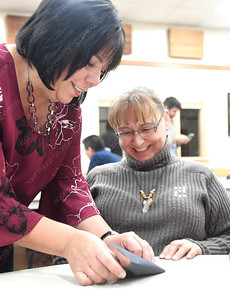 Bev Best, left, showes Carol Johnson how to fold a raven at UNBC Wednesday. Students, staff, and faculty helped kick off the 1000 Ravens for Reconciliation campaign. An ancient Japanese legend promises that anyone who folds 1000 origami cranes will be granted one wish. The Raven is an important figure within First Nations culture, symbolizing change and transformation. UNBC's First Nations Centre is asking you to make an origami raven as part of our goal to make 1000 Ravens in one year to symbolize a University-wide wish for Reconciliation. Citizen photo by Brent Braaten