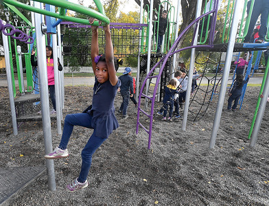 Daniella Vdengwu, a Grade 2 student at Sacred Heart School plays on some of the new playground equipment over the lunch hour on Thursday. The school is celebrating its 70th anniversary by holding a bbq Thursday evening. Its also a chance to thank the many donars, including IDL Projects, Pittman Ashphalt and Novatone, that contributed to the over $200,000 refurbishment of the playground, basketball courts, garden area and field at the school. Citizen photo by Brent Braaten