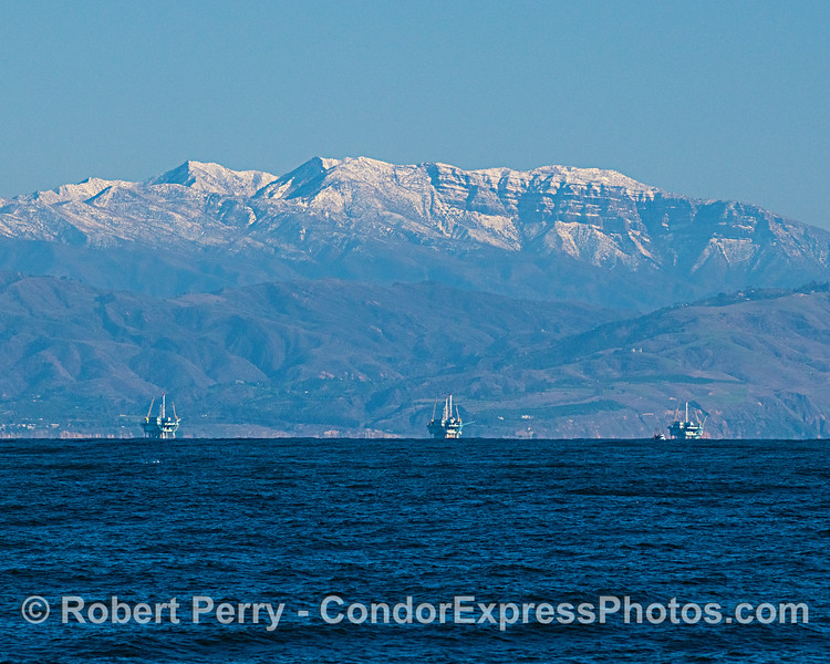 A bit of snow atop the Santa Ynez range above the offshore oil platforms near Carpinteria.