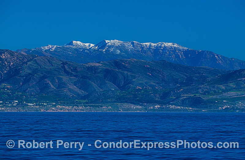 Carpinteria, California with a light dusting of snow on the Santa Ynez Mountains, as views from 3 miles offshore.