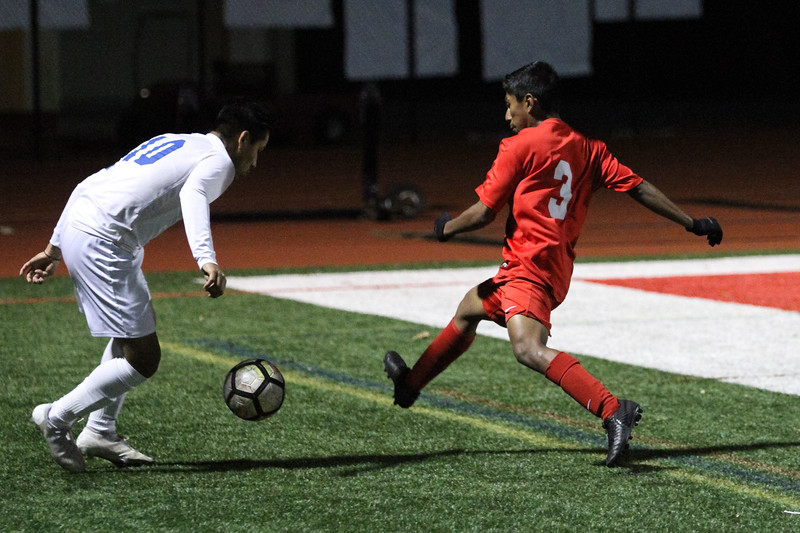 Fallbrook's Miguel Rojas attempts to stop San Pasqual's advance, Feb. 6. The Warriors won the game, 2-0. Shane Gibson photos