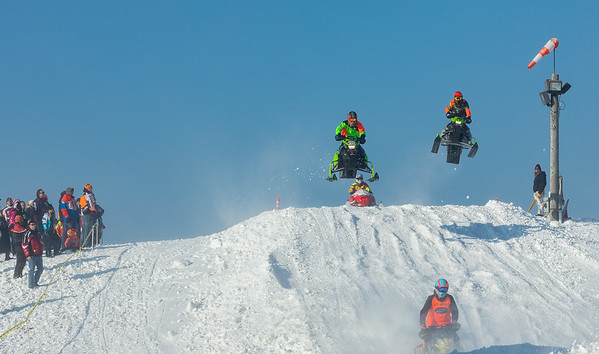 03,DA029,DJ,onlookers enjoy Sunny skies 50 degree temps and snowmobile racing