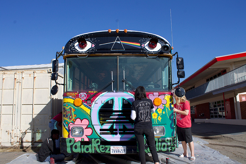 Students paint symbols and patterns of the 60s on the front of the bus.  Maggie Schmutz photos