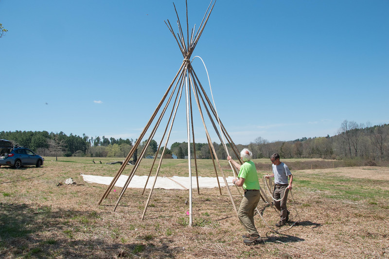 Tony Godino and Bill Bradsell secure the support poles for the teepee structure in the Ward Pound Ridge Meadow in preparation for the upcoming Leatherman's Loop 10k Trail Race.
