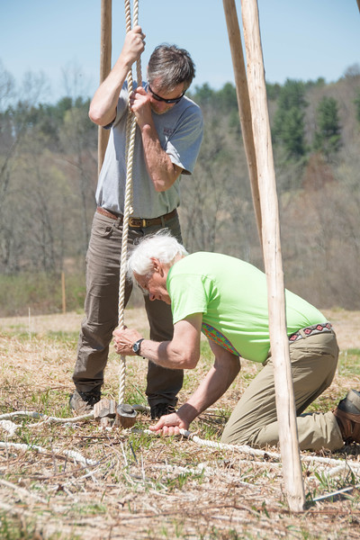 Bill Bradsell holds the center rope as Tony Godino ties down the support poles for the teepee structure in the Ward Pound Ridge Meadow in preparation for the upcoming Leatherman's Loop 10k Trail Race.