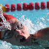 Fallbrook High School's Kaiah McNutt swims in the 200-meter freestyle race against Escondido Charter High School.