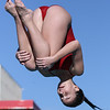 Fallbrook High School's Chiara Curnow flips during her dive against Escondido Charter High School.