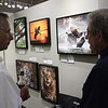 Guests look at the wildlife photography of Jeff Nadler on display at the Fallbrook Art Center.