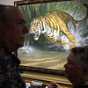 Wildlife paintings on display by artist Lee Kromschroeder on display during the Reflections of Nature art show reception at the Fallbrook Art Center.