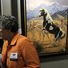 Vicki Higgins takes a look at the wildlife paintings on display by artist Lee Kromschroeder during the Reflections of Nature art show reception at the Fallbrook Art Center.
