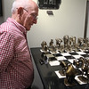 Frank Kreidl views a wildlife chess board created by artist Mark Nordquist on display during the Reflections of Nature art show reception.