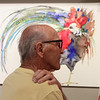 William Giannini views the work of artist June Jurcak on display during the Reflections of Nature art show reception.