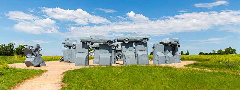 DA040,DP,Panoramic_Blue_Partly_Cloudy_Skies_Over_Carhenge_in_Nebraska