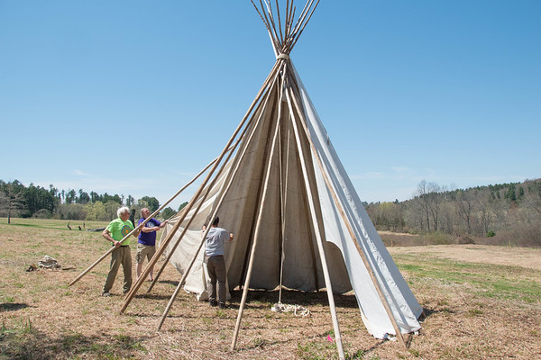 Tony Godino, Mike Surdej, and Bill Bradsell assemble the Teepee in the Ward Pound Ridge Meadow in preparation for the upcoming Leatherman's Loop 10k Trail Race.
