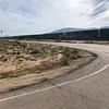 mile long train; cross marks death site (Mexican custom)