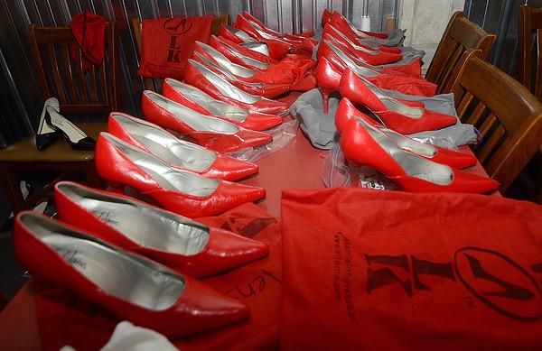 MET 040519 WALK RED SHOES