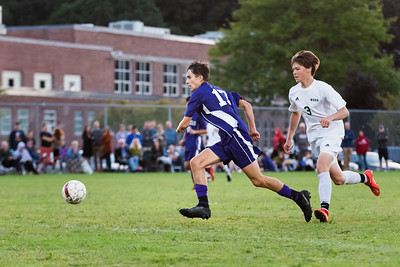 KELLY FLETCHER, REFORMER CORRESPONDENT -- Alex Lier charges after the ball with Blake Heston in pursuit during Brattleboro's face off with Woodstock on September 5th.