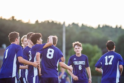 KELLY FLETCHER, REFORMER CORRESPONDENT -- The team congratulates Luke Williams for goal number one during the Colonels' season opener against Woodstock on Thursday