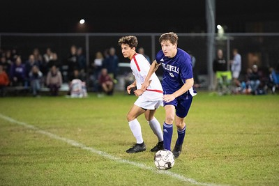 KELLY FLETCHER, REFORMER CORRESPONDENT -- Luke Williams looks for a way through the Raider's defense as he dribbles past center field