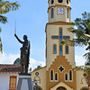 Solento town square with statue of Simon Bolivar and Our Lady of Carmen Catholic Church