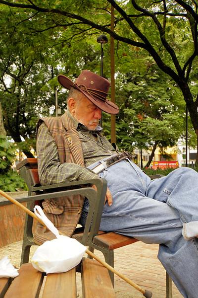 Man snoozing in Parque El Poblado