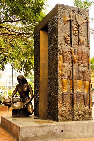 Statue of indigenous and the conquistadors in Parque El Poblado