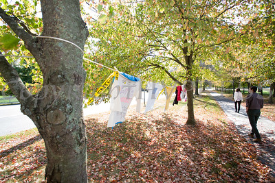 People look at the Clothesline Project, which is a powerful visual display of T-shirts bearing the stories of victims and survivors of domestic violence which  were on display as Safe Homes of Orange County kicked off Domestic Violence Awareness Month on Tuesday, October 1, 2019 at the Orange County Government buidling in Goshen, NY. Hudson Valley Press/CHUCK STEWART, JR.