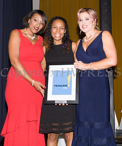 Sarita Green, left, and Kellyann Kostyal-Larrier, right, present Kristen Feden Gibbons, center, with an award during the Fearless! (Safe Homes of Orange County) 33rd Anniversary and Celebration of Hope Gala on Friday, October 25, 2019. Hudson Valley Press/CHUCK STEWART, JR.