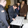 Orange County Executive Steven Neuhaus signs a ceremonial check for $5,000 on Thursday, January 3, 2019 to support the City of Newburgh Junior Police Cadet Academy program. City of Newburgh Police Chief Doug Solomon, Orange County Legislator Kevindaryan Lujan and Newburgh Mayor Torrance Harvey watch.Hudson Valley Press/CHUCK STEWART, JR.