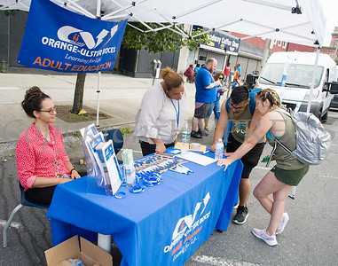 Orange-Ulster BOCES Adult Education representatives were handing out information during the all-free National Night Out event that took place in the City of Newburgh on Tuesday, August 6, 2019. Hudson Valley Press/CHUCK STEWART, JR.