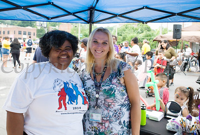 The Ferry Godmother and Amy Garcia of the Grand share a moment at the all-free National Night Out event that took place in the City of Newburgh on Tuesday, August 6, 2019. Hudson Valley Press/CHUCK STEWART, JR.