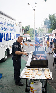 City of Newburgh Police cook up hamburgers during the all-free National Night Out event that took place in the City of Newburgh on Tuesday, August 6, 2019. Hudson Valley Press/CHUCK STEWART, JR.