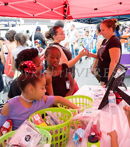 Information about the 3rd Annual Omani and Tabby Day happening on August 17 was available, as were free goodies at this table, during the all-free National Night Out event that took place in the City of Newburgh on Tuesday, August 6, 2019. Hudson Valley Press/CHUCK STEWART, JR.