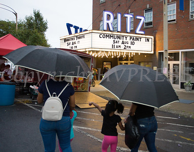 Umbrellas signaled an end to the fun at the all-free National Night Out event that took place in the City of Newburgh on Tuesday, August 6, 2019. Hudson Valley Press/CHUCK STEWART, JR.