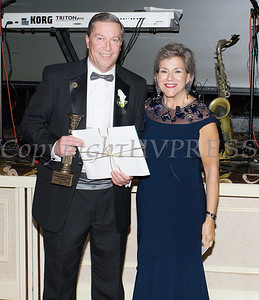 Michael Gilfeather, President & CEO of Orange Bank & Trust accepts the Pillar Award from Linda S. Muller, President & CEO Cornerstone Family Healthcare during the 20th Annual Pillars of the Community Gala held at Anthony's Pier 9 on Saturday, November 2, 2019. Hudson Valley Press/CHUCK STEWART, JR.