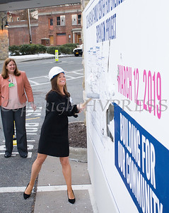 "Kate Dabroski, Vice President, Marketing, Public and Community Relations takes a swing at the wall as St. Luke's Cornwall Hospital hosted a ""wall breaking"" and kick off ceremony to celebrate the beginning of the Kaplan Family Center for Emergency Medicine Expansion Project on Tuesday, March 12, 2019. Hudson Valley Press/CHUCK STEWART, JR."
