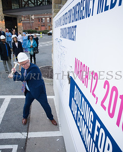"Daniel Maughan, SLCH Senior Vice President of Transformation takes a swing at the wall as St. Luke's Cornwall Hospital hosted a ""wall breaking"" and kick off ceremony to celebrate the beginning of the Kaplan Family Center for Emergency Medicine Expansion Project on Tuesday, March 12, 2019. Hudson Valley Press/CHUCK STEWART, JR."
