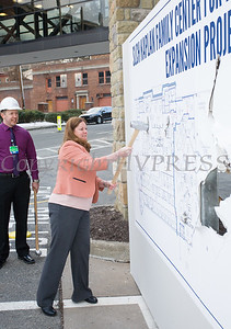 "Kathy Sheehan, SLCH Director of Emergency and Trauma Services takes a swing at the wall as St. Luke's Cornwall Hospital hosted a ""wall breaking"" and kick off ceremony to celebrate the beginning of the Kaplan Family Center for Emergency Medicine Expansion Project on Tuesday, March 12, 2019. Hudson Valley Press/CHUCK STEWART, JR."