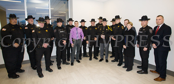 Orange County Sheriff Carl E. DuBois is surrounded by members of the Sheriffs Department after he was sworn in to his unprecedented fifth term as Sheriff during the Orange County Legislative organizing meeting in Goshen, NY on Thursday, January 3, 2019. Hudson Valley Press/CHUCK STEWART, JR.