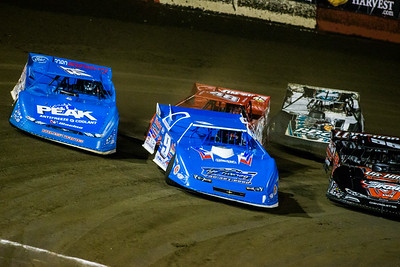 Billy Moyer (9) and Josh Richards (14) lead a heat race to green