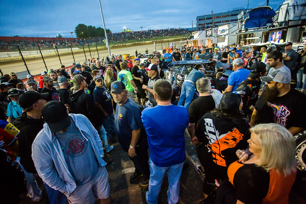 Fans gathered around Scott Bloomquist's car while repairs are made